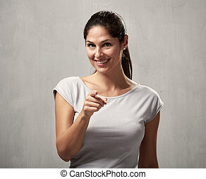 Woman pointing to the camera