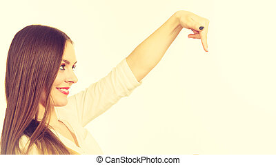 Woman pointing with finger at copy space