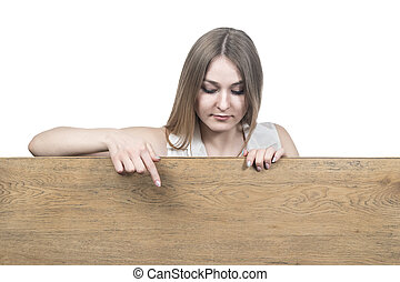 woman points down to a wooden board