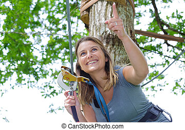 woman poised to descend zip wire