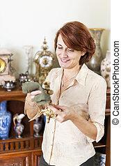 Woman polishing antiques