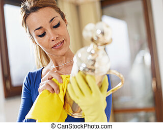 woman polishing silverware