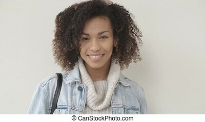 Afro American girl in casual clothes is looking at camera...