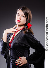 Woman portrait against dark background