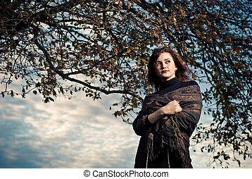 woman portrait at fall tree