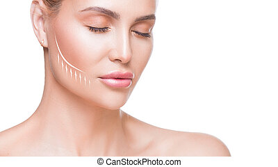 Woman portrait close up. Beautiful woman with lifting arrow on face over white background.