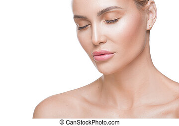 Woman portrait. Close up view of a woman with closed eyes. Soft clean healthy skin. Natural beauty. Skin care concept