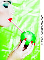 Woman portrait drinking apple juice