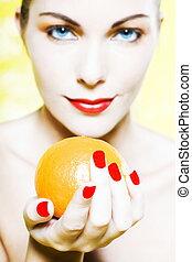 Woman Portrait offer an orange smiling