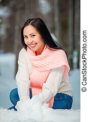 Woman portrait outdoors on snowy white winter day.