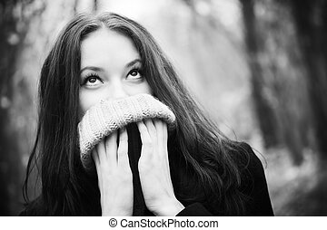 Woman portrait with big woollen collar for cold weather. ...