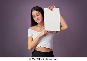 woman portrait with blank white board.Teenager girl hold white blank paper.