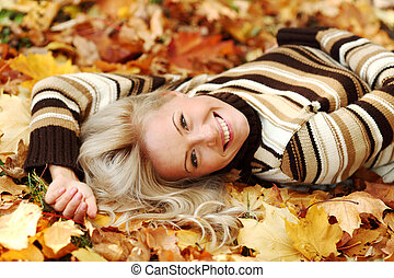 woman portret in autumn leaf close up