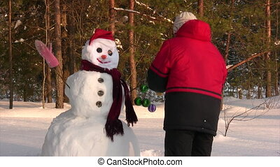 Woman poses with snowman