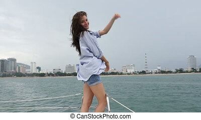 Woman posing and looking at camera on yacht
