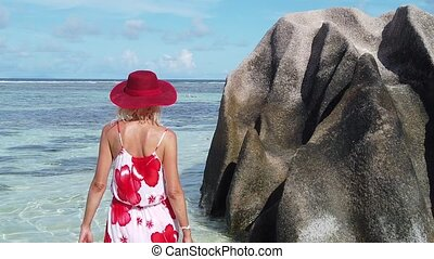 Woman posing at Anse Source d'Argent - SLOW MOTION:...