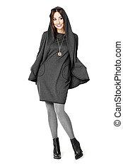 Woman Posing In A Gray Dress