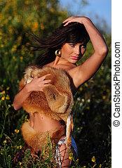 Woman Posing In Bikini And Fur