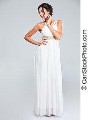 Woman posing in fashion dress