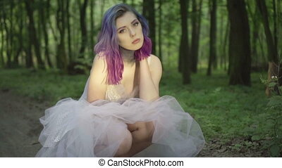 Woman posing in forest white dress