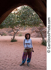 Woman posing in front of a cave
