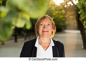 Woman posing in green park