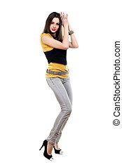 Woman posing in grey jeans