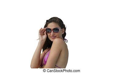 Woman posing in her bikini with sunglasses