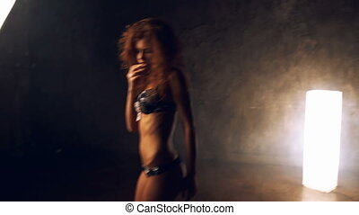 Woman posing in lingerie clip. - Young slim woman with red...