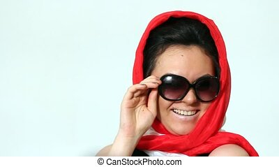Woman posing in Sophie Loren style in scarf