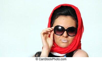 Woman posing in Sophie Loren style in scarf