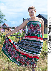 Woman posing in sundress in sunny summer day