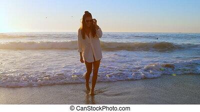 Woman posing in sunglasses in the beach 4k - Stylish woman...