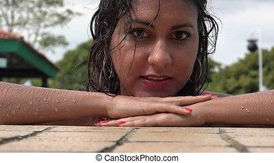 Woman Posing in Swimming Pool