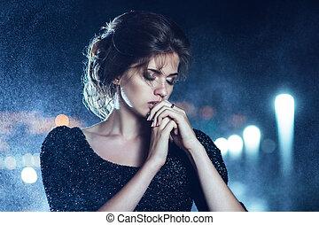 Woman posing in the rain. - Beautiful woman in black dress ...