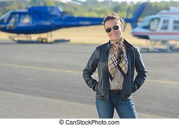 woman posing in the tarmac