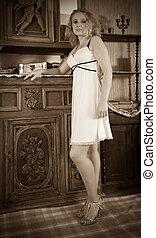 woman posing in vintage room