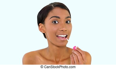 Woman posing lip gloss on white background