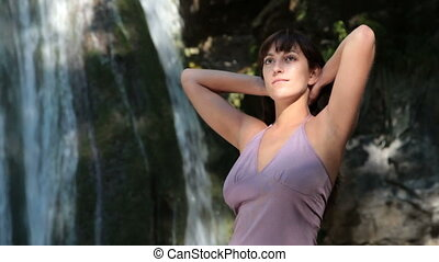 woman posing near the waterfall
