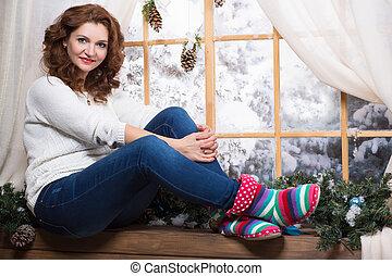 Woman posing on the windowsill