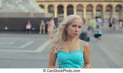 Woman posing while standing in the Duomo Square near horse...