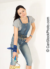 Woman posing with a paint roller