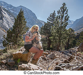 woman posing with dog on vacation