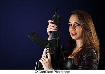 Woman posing with gun