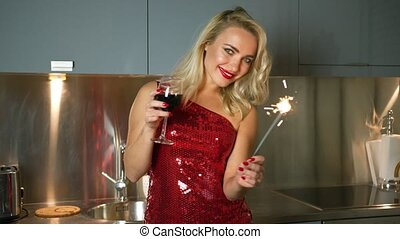 Woman posing with sparkler an wine