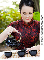 woman pouring chinese tea