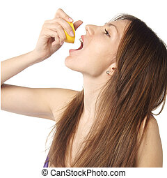 woman pouring juice from lemon slice in her mouth