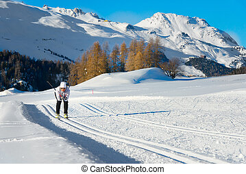 Woman practicing cross-country skiing
