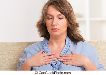 Woman practicing energy medicine - Woman practicing self...
