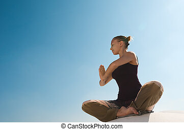 Woman practicing padmasana - Attractive redhair woman...